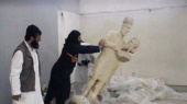 Isis fighters destroy ancient artefacts at Mosul museum